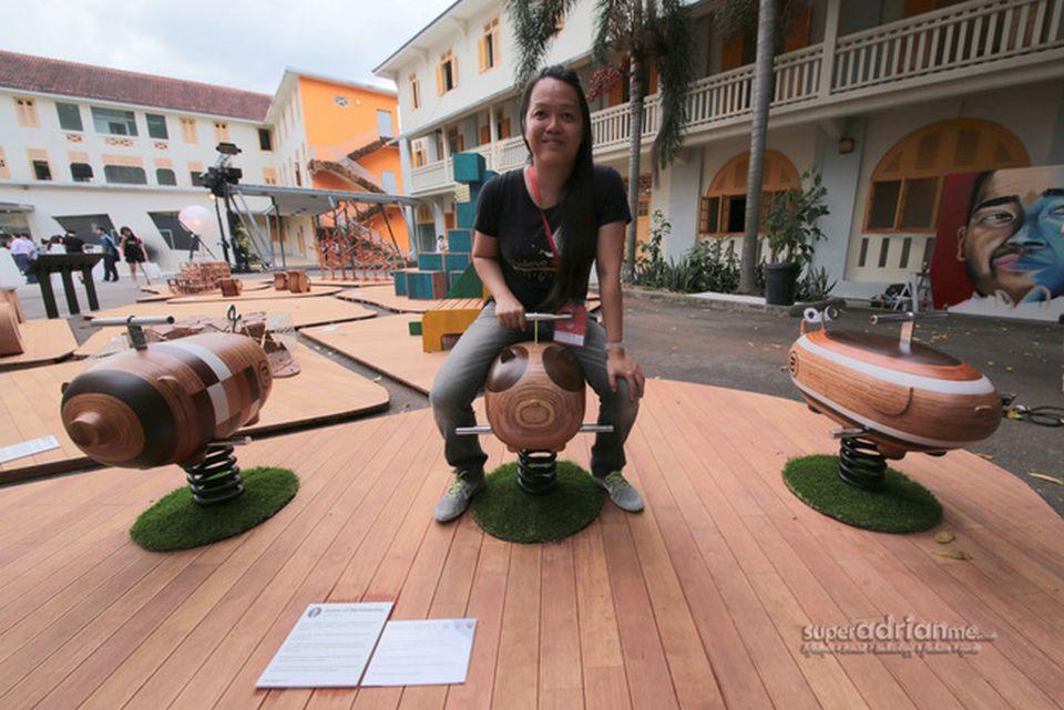Designer Chan Wai Lim with her design in SingaPlural 2015, Singapore