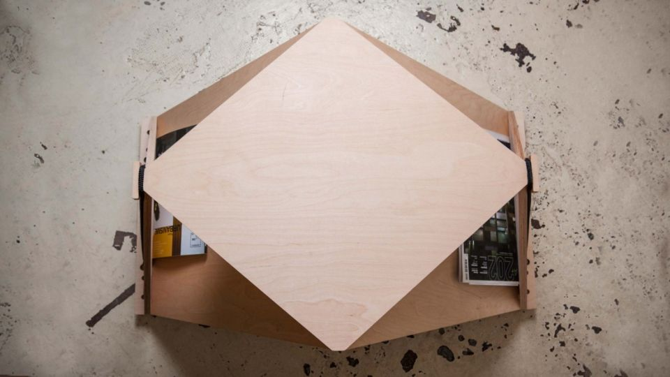 The diamond shaped surface serves all coffee table functions