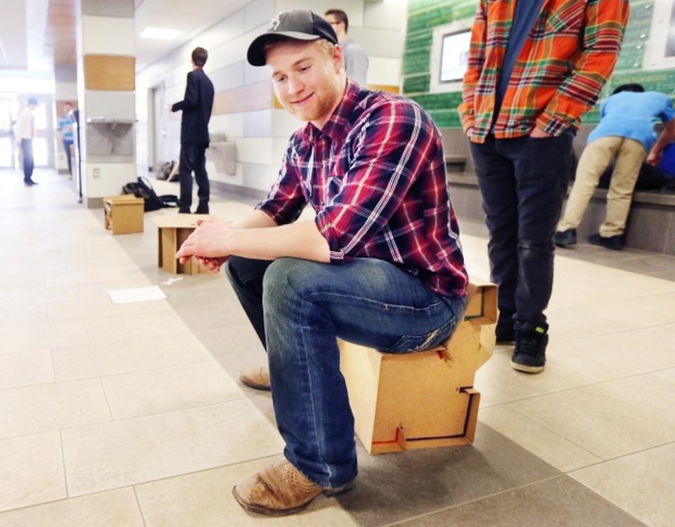 Engineering students build cardboard furniture for refugee camps