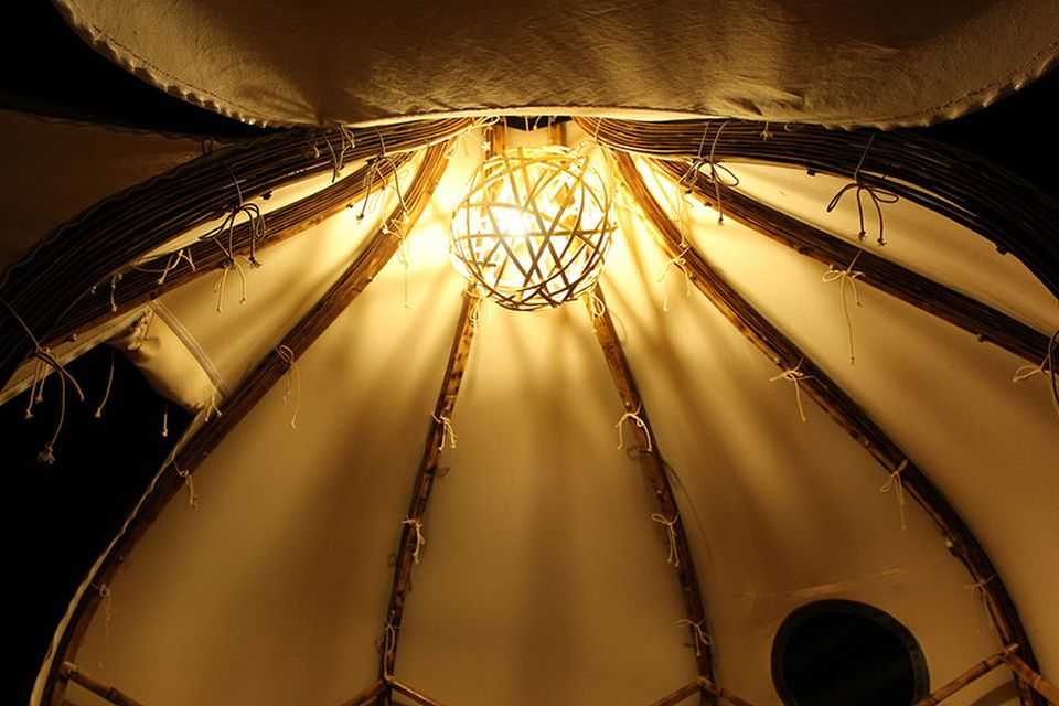 Lamp made from random congregation of bamboo strips