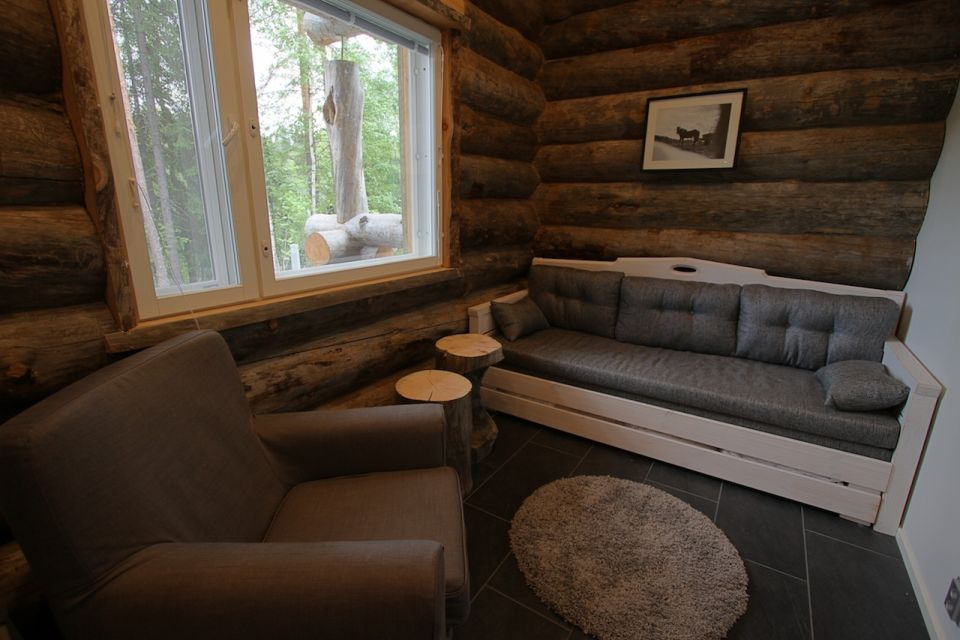 The electric sauna is accessed through the den
