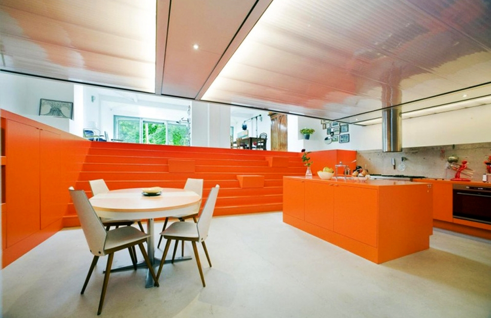 Ambulance garage turned into modern home with orange interior