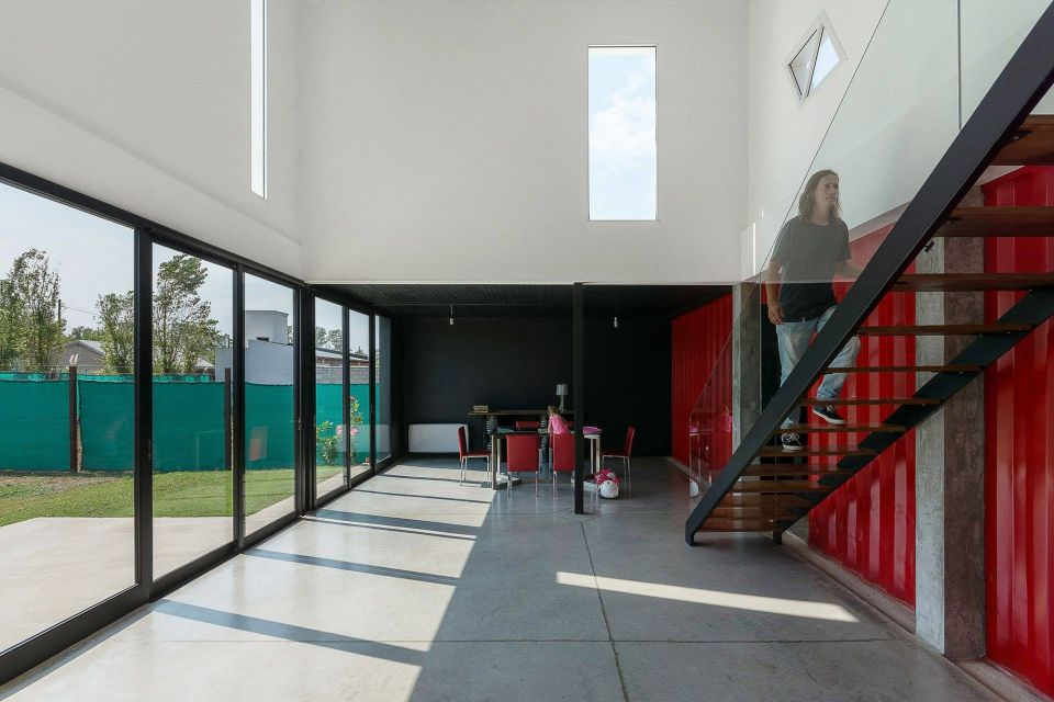 Use of red, black and white color to give house both modern and simple look