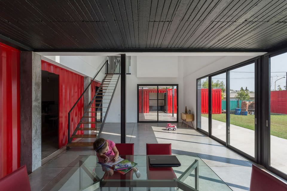 The house is designed with generous glass walls and windows