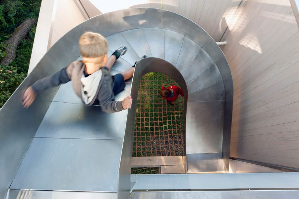 The steel slides provide a fun way to reach main space from the space desk