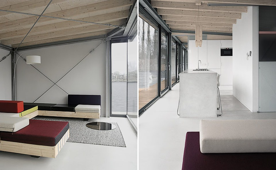 Custom-made minimalist interiors add simplicity and modernity to the houseboat