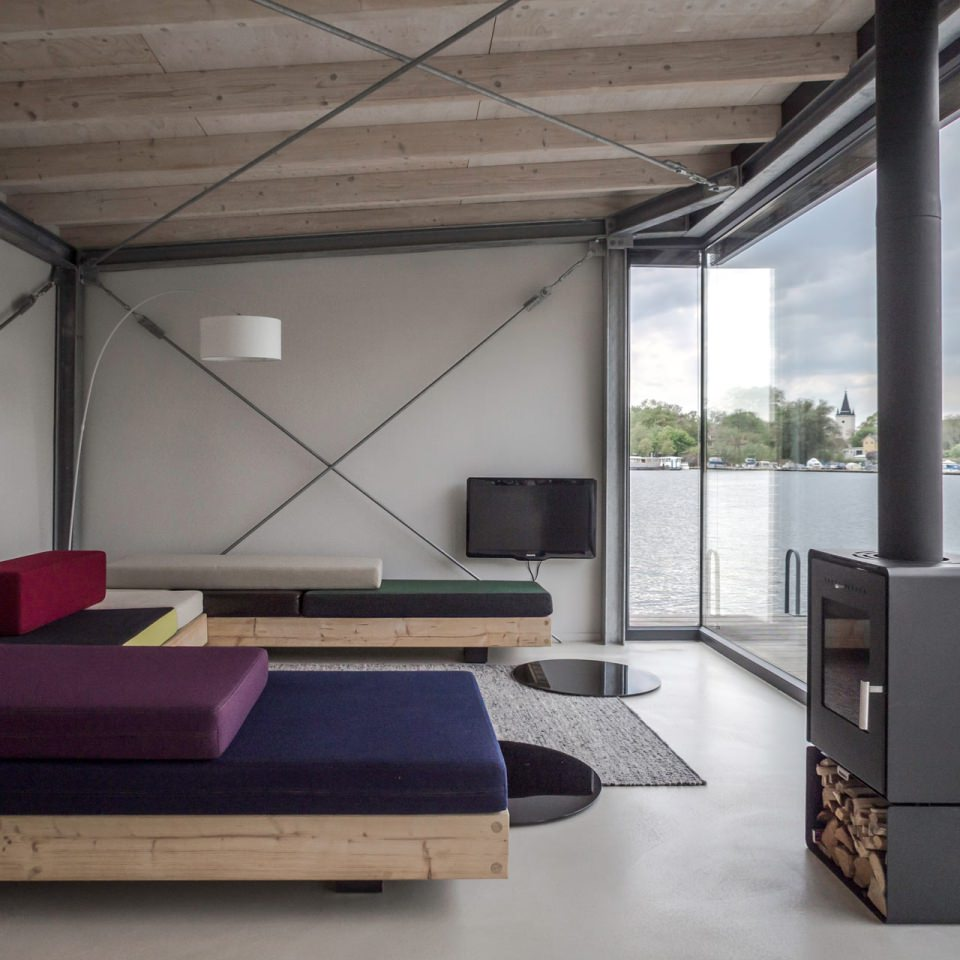 The living room is equipped with retractable double bed and low-rising sofa