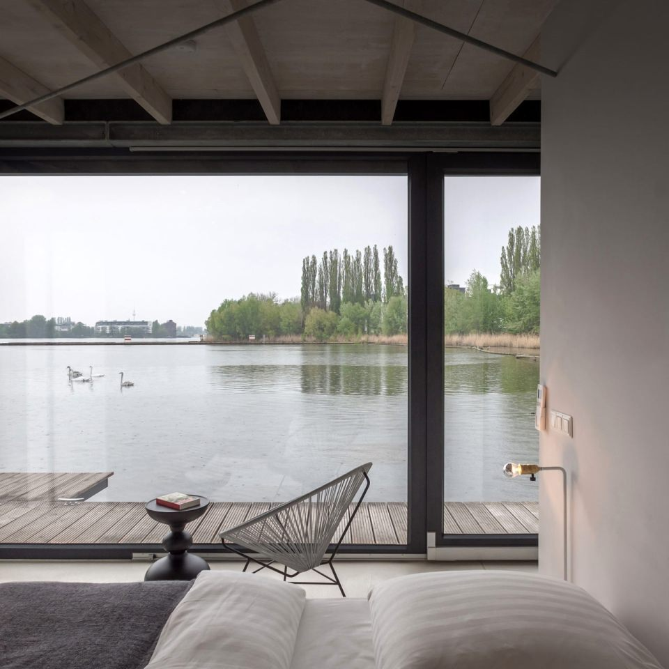 The main bedroom with beds overlooking the water