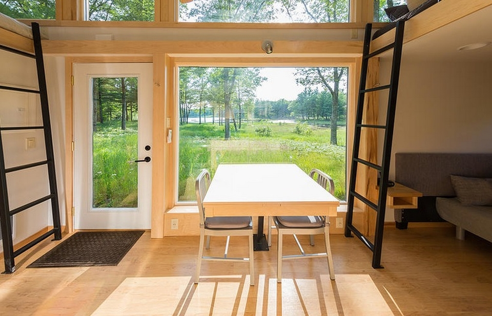 Dining area with over-sized window to create space for natural light