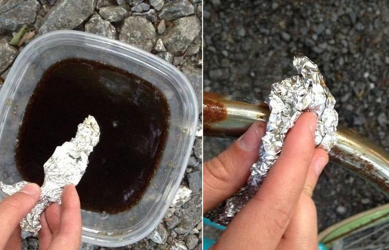 removing rust from metal furniture using aluminum foil, saltwater and cold drink
