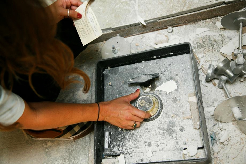 Couple discovers a mystery safe under kitchen floor