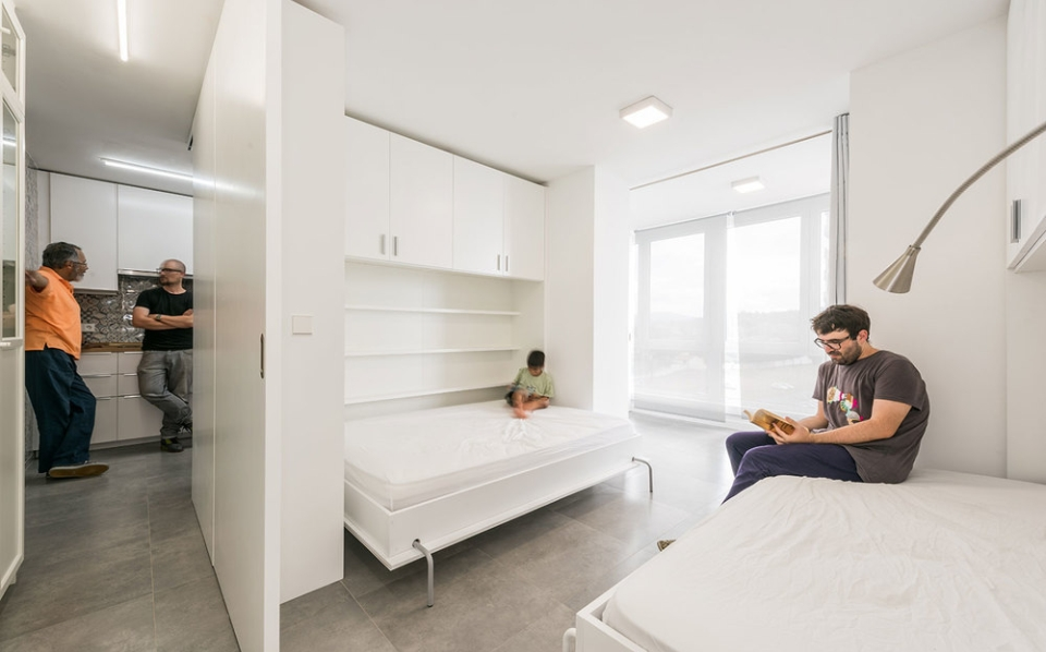 Murphy-styled beds and pullout dividers to create multiple small spaces