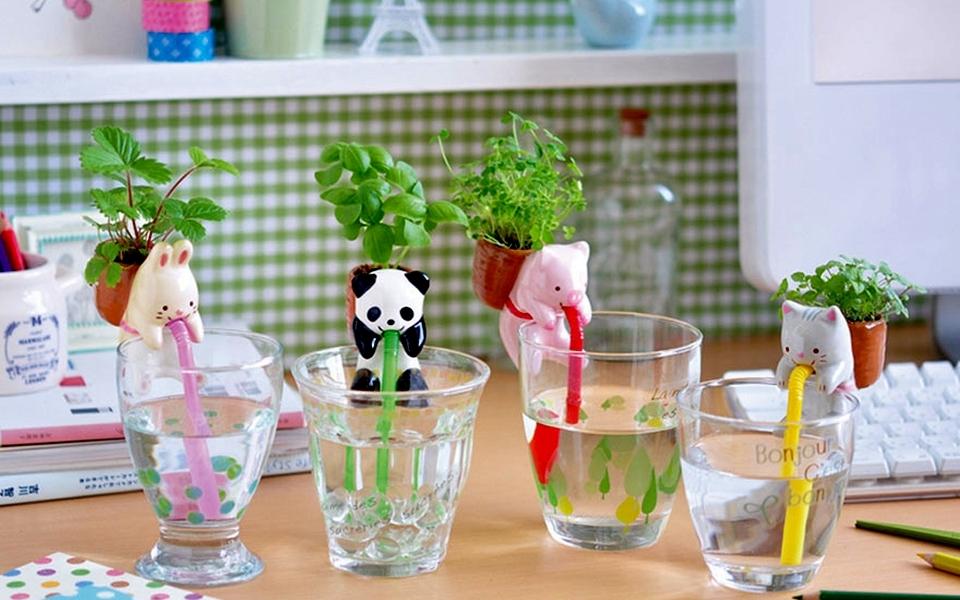 Self-watering animal planters