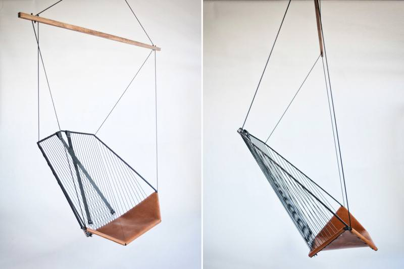 Simple yet resilient suspended chair is made from leather an steel
