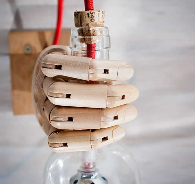 Upcycled mannequin hand turned into industrial wall sconce