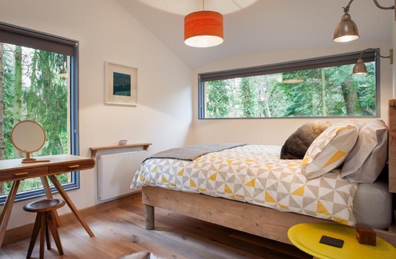 The bedroom with windows to offer view of surrounding areas