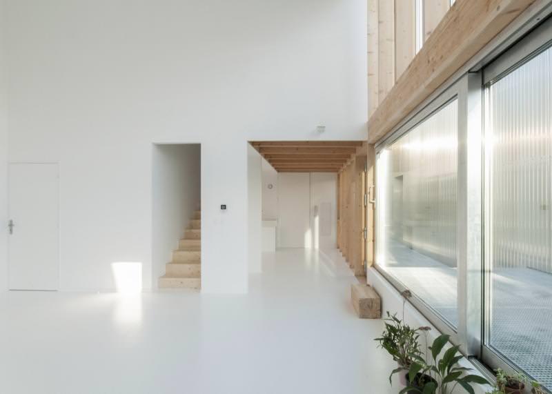 Large triple-glazed sliding doors and windows let in natural light