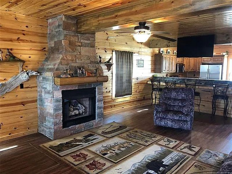 You can Buy this House with Fishing Hole in Living Room for $229K