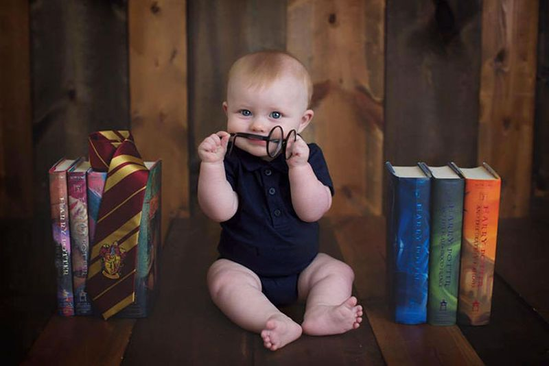 Kid with all seven books of the Harry Potter series