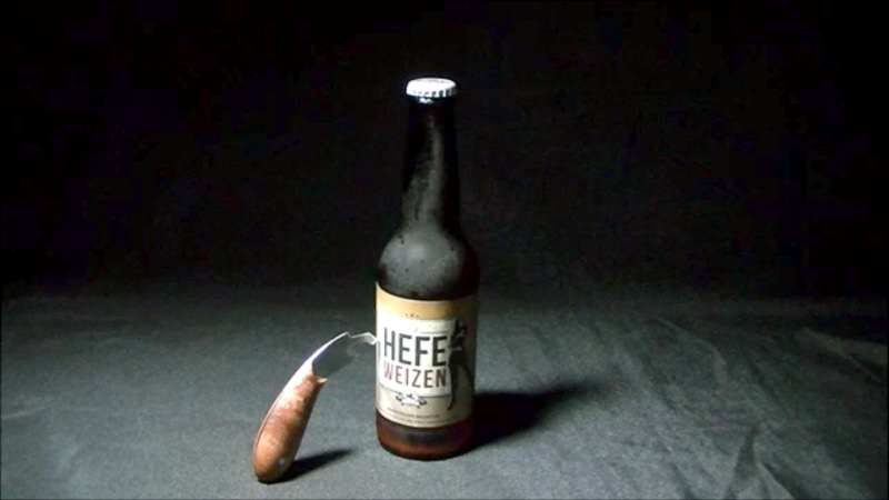 Table saw blade bottle opener
