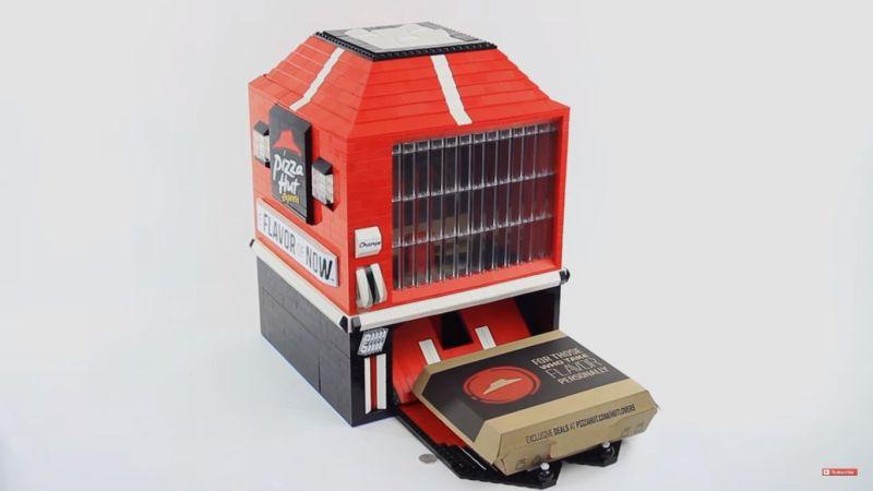 Mini pizza hut dispensing machine designed with LEGO bricks