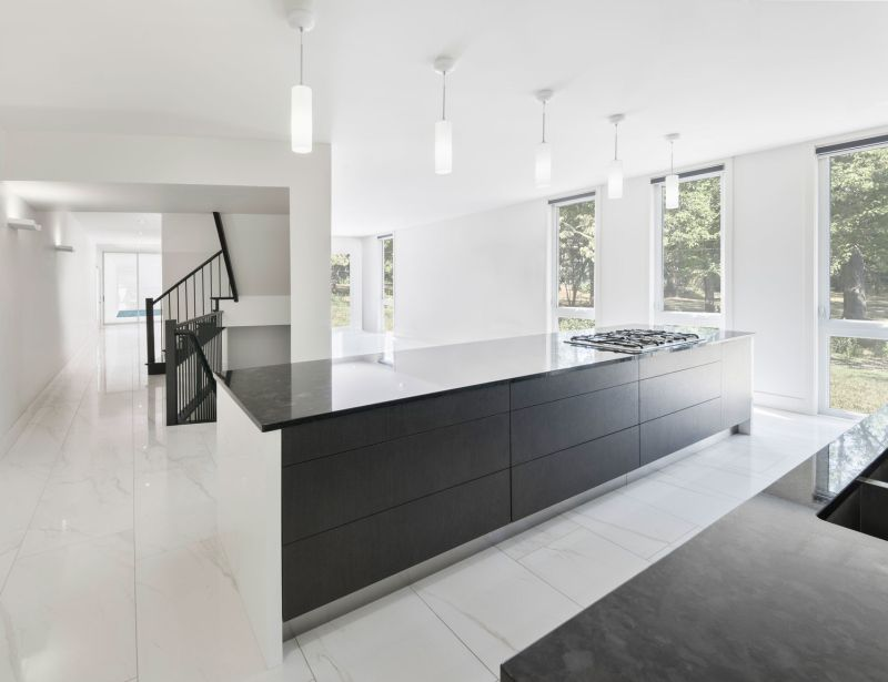 Black cabinetry and staircase to contrast with white