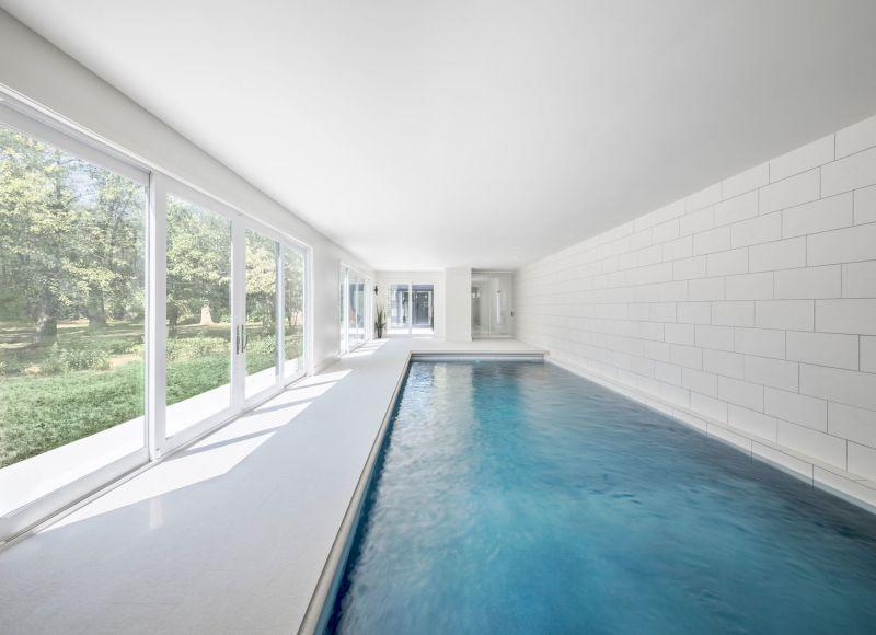 Indoor pool that opens in garden outside