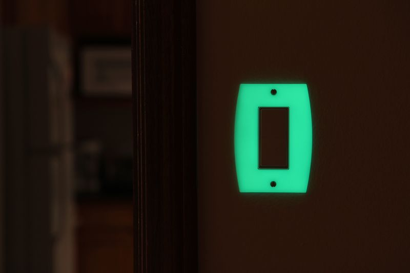 Translucent glowing switch plate with fire retardant foam shell inside