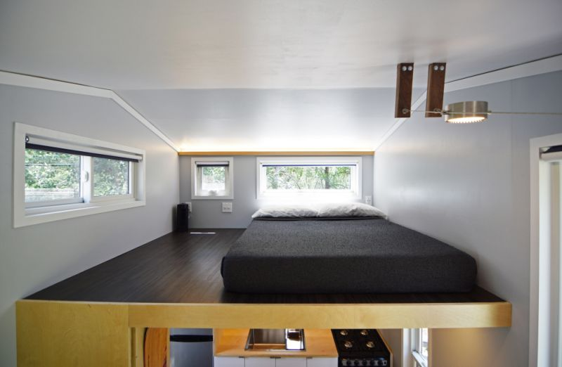 A loft bedroom with elongated windows