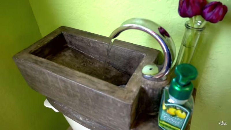 Utilize water at homes with DIY concrete toilet tank sink