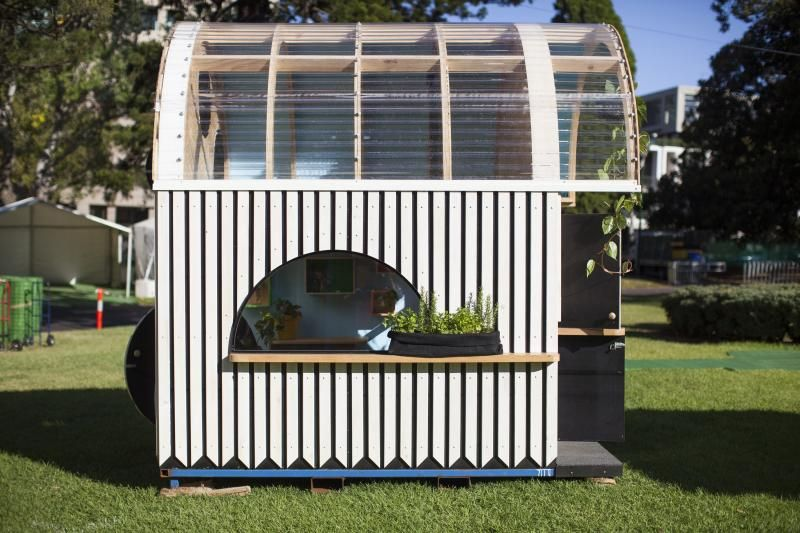 Modern Playhouse's exteriors designed with timber with black and white strips
