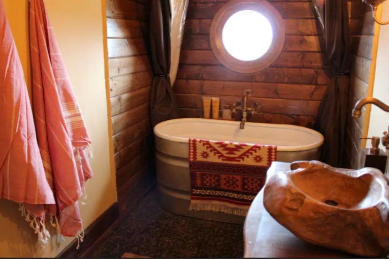 A bathroom with a porcelain bathtub