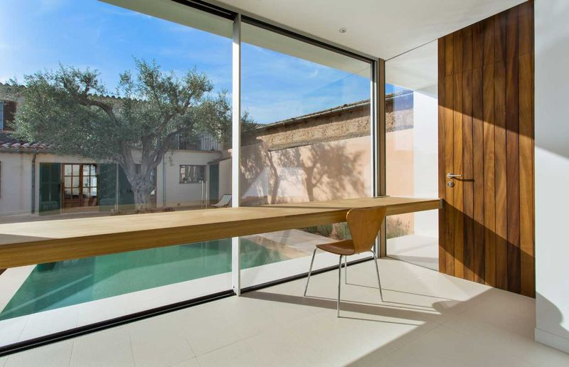 This home office in Spain overlooks a swimming pool