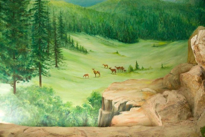 Greenish mountains with animals