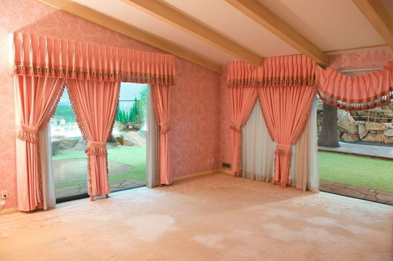 Pink colored drapes in main bedroom