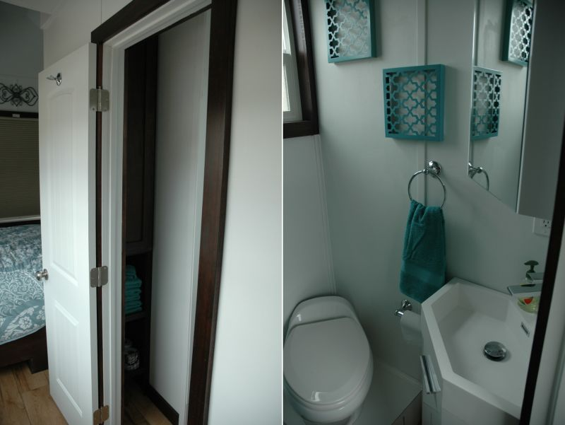 Bathroom with a porcelain RV toilet and Corian shower