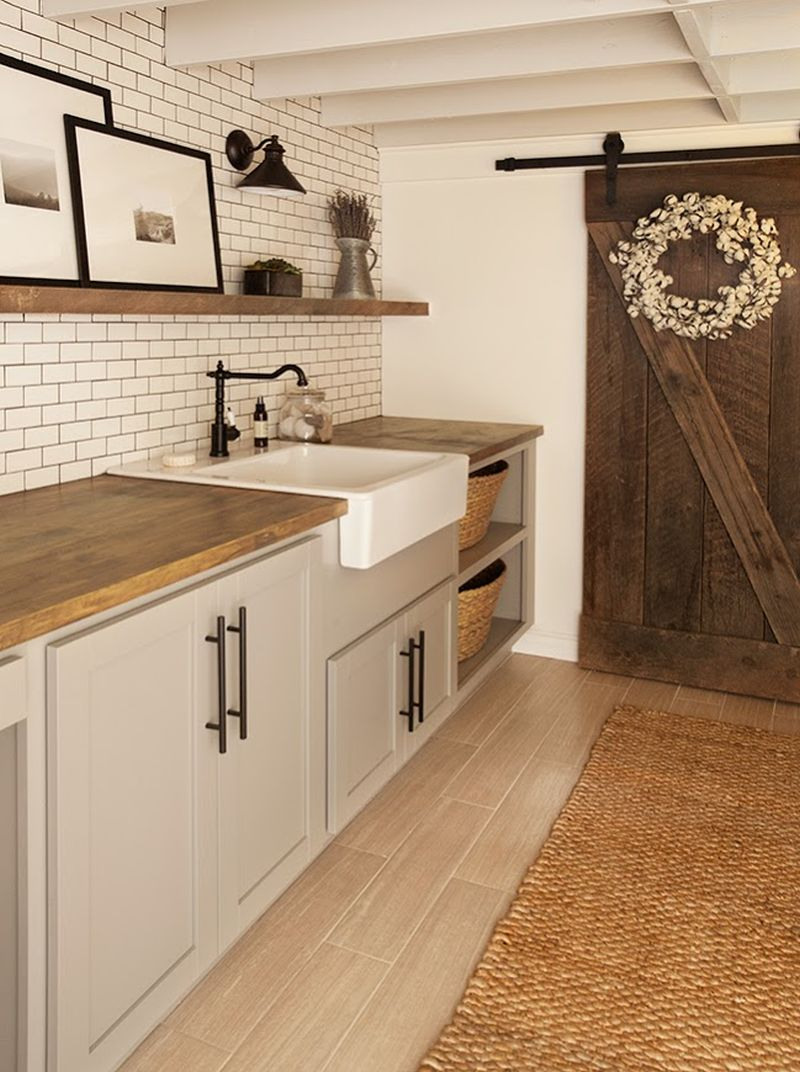 Smart use of reclaimed wood in shelving and doors to giveit a rustic look