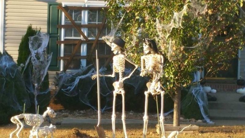 Mr. Bones and his wife gardening in the yard