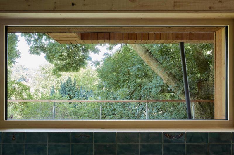 Big horizontal window in the master suite