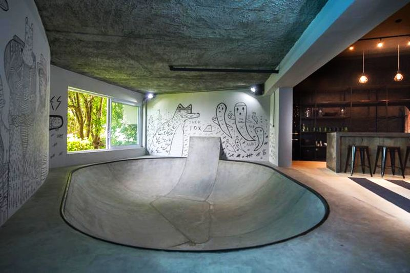 Concrete skating bowl surrounded with amazing street art
