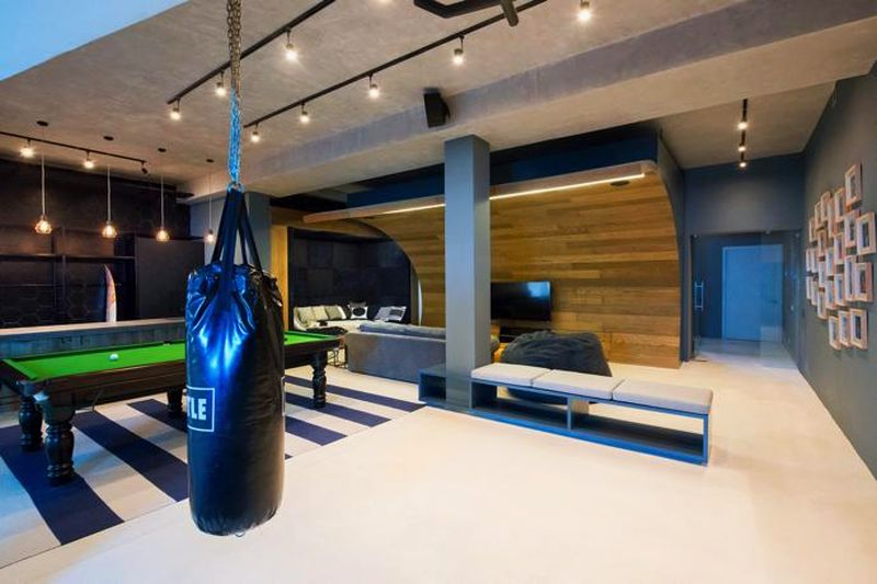 Punching bag next to the bean bag couch