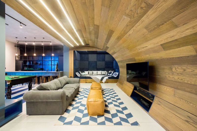 A floor-to-ceiling wooden arch over the lounge-cum-theater-area