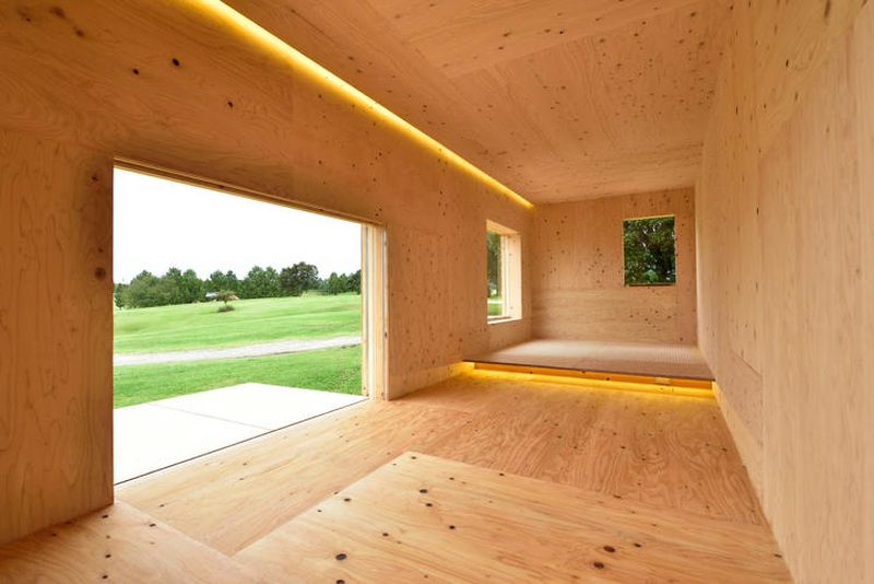 Big glass windows that could be covered with folding panels