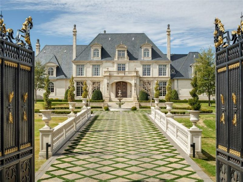 Attractive facade and lawn with tiled path