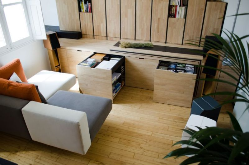 Transformer-style storage solutions maximize this micro-apartment