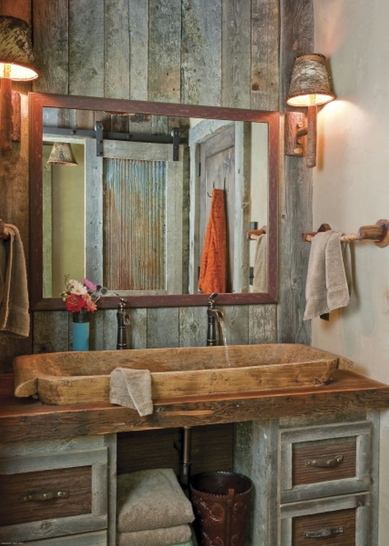 Recycled wooden bowl as sink in complete bathroom