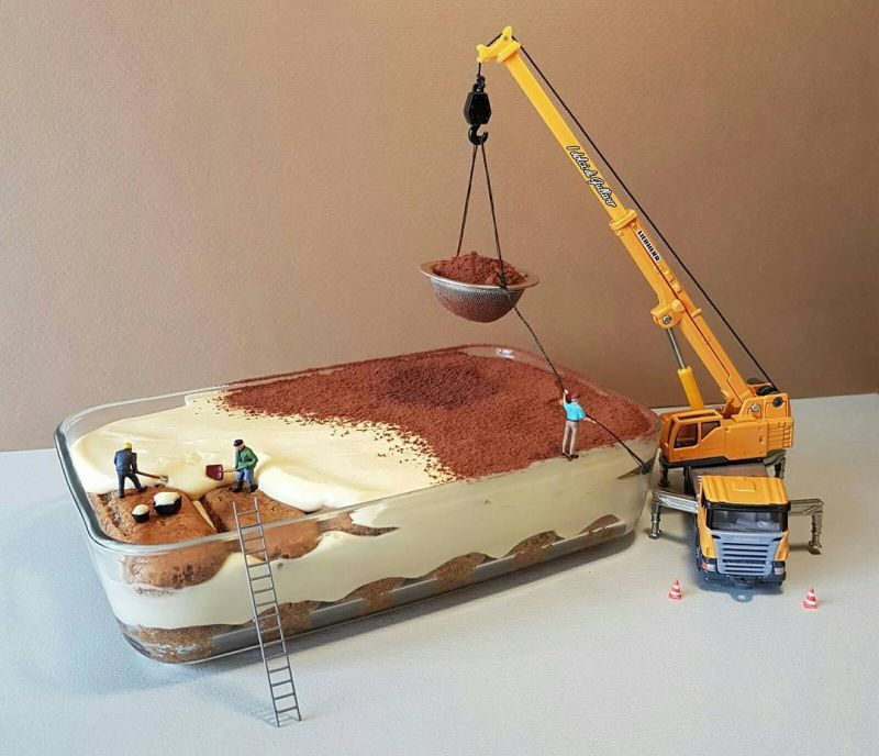 Miniature figures of men at a mining site made of cake and chocolate