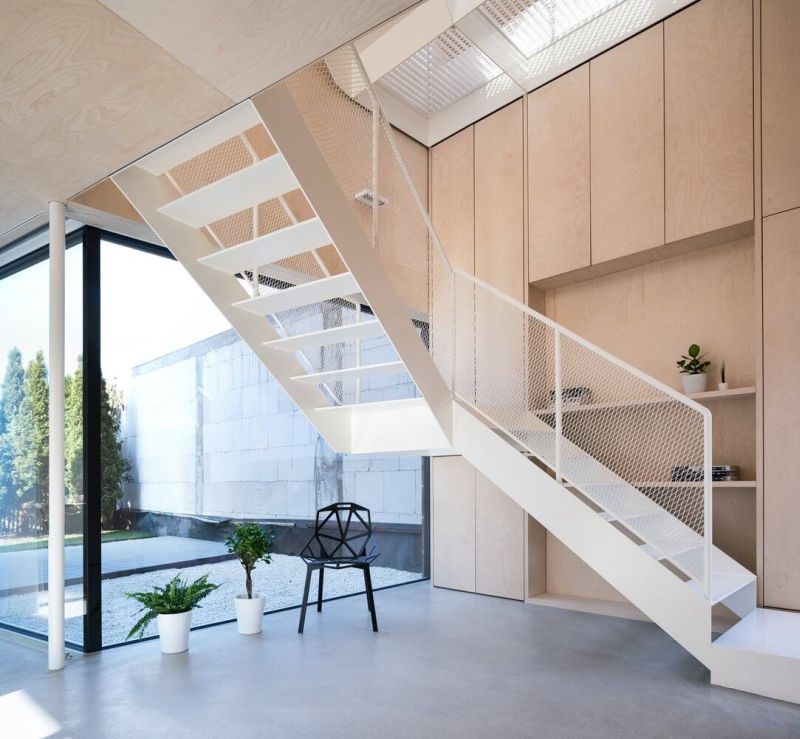 Shelving alongside stairs to first floor