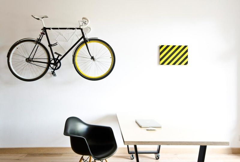 Wall mount for bicycle of the owner