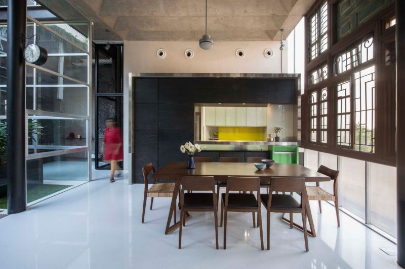 Elegant kitchen with wooden dining table and chairs